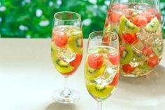 Ultimate White Wine Sangria...pineapple juice, oj, kiwis, watermelon, Riesling, Triple Sec, Apple Schnapps, sprite/7up, soda water...