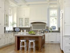 white kitchen, wood island