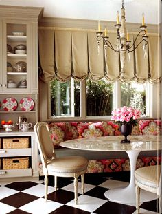 patterned sofa in the dining room - surrounded by bookcases