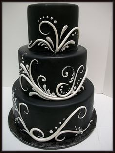 Absolutely LOVE it! I know black is a bit morbid for a wedding to some people but the design of this cake is lovely! I likely wouldn't use it at my own but I still think it's beautiful! black cake, black weddings, wedding ideas, swirl, romantic weddings, white weddings, white cakes, wedding cake recipes, white wedding cakes