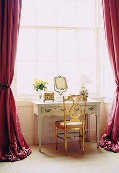 Vanity/writing desk and gilded chair bathed in sunlight | Georgian townhouse of Roséline Lohr (founder of This is Glamorous) in Edinburgh, Scotland