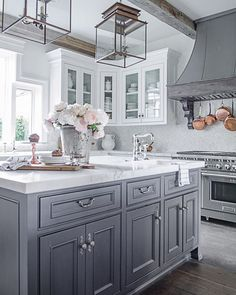 I am always so complimented by someones interest in the details of our home. By far the three most common questions Im asked are:  1) Where are your kitchen pendants from?  2) What color is your center island?  3) What color/material is your range hood? I wanted to let you know that all of the answers to those questions and more are on my website. Sanctuaryhomedecor.com You can get there by clicking the blue link on my profile page and going to the DESIGN SOURCES AND PAINT COLORS tab or #Kitchen