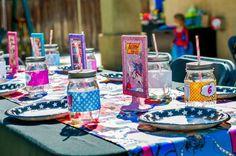 Tablescape at a Superhero Party with Lots of Fun Ideas via Kara's Party Ideas | KarasPartyIdeas.com #SuperheroParty #PartyIdeas #PartySupplies #Tablescape