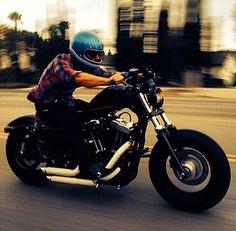 Harley Davidson Sportster 48 with rider in blue vintage full face metalflake helmet