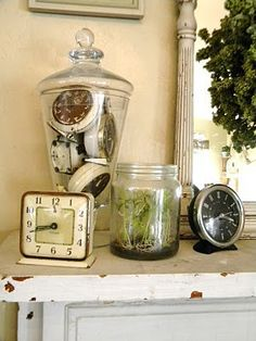 vintage clocks and apothecary jar