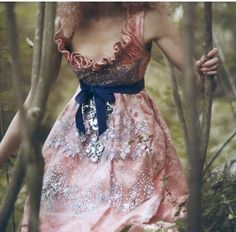 Enchanting, that's the word for it. Lovely embellishments on the dress.