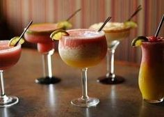 From left, a raspberry margarita, strawberry margarita, mango-strawberry margarita, pineapple margarita and a mango-strawberry daiquiri at Fajita Republic. / Evan Siegle/Press-Gazette