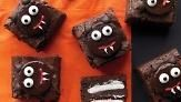 How to Decorate Scaredy-Cat Brownies Video - Transform chocolate brownies into adorably spooky treats with peppermint patties and candy eyes.