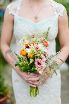 sunset bouquet ideas #bridalbouquet #weddingflowers #weddingchicks http://www.weddingchicks.com/2014/03/10/unique-and-earthy-wedding/