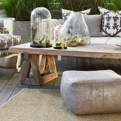 A covered deck is the perfect setting for pieces like this coffee table with sawhorse-style legs. You can assemble one for less than $150. For the legs, use galvanized-steel sawhorse brackets, about $3 per pair, boxed out with 2x4s. Top them with Numerär beech butcher block, from about $130; ikea.com. | Photo: Tria Giovan/GAP Interiors