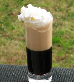 Blow Job - .75 oz.Kahlua, .75 oz.Baileys Irish Cream, Whipped Cream. Pour the Kahlua into a 2 oz. Shot glass. Next, pour the Baileys over the back of a spoon so that it floats on top of the heavier Kahlua. Add a little Whipped Cream on the top, and it's bottoms up!