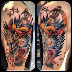 Wolf head with a dagger...tattoo made by Sean Martin