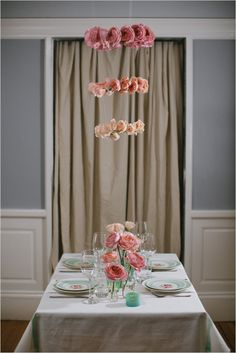 Pretty pink rose ombre chandelier and table decor. Captured By: Lara Kimmerer ---> http://www.weddingchicks.com/2014/05/28/3-garden-rose-diys-youll-love-from-blue-jar-events/