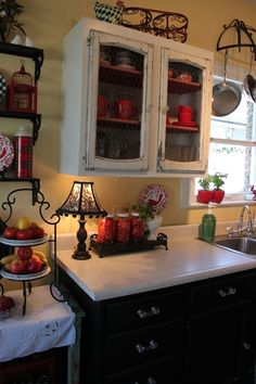 Our Kitchen: The Opulent Cottage - love the black and white cabinets