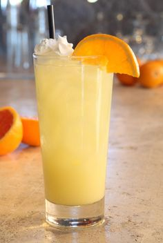 Orange Dreamsicle    (1.5 oz. Pinnacle Whipped Vodka    2 oz. orange juice    1 oz. lemon-lime soda    1 oz. soda    .25 oz. cream of coconut    Squeeze 1 lemon slice    Orange slice and whipped cream for garnish)