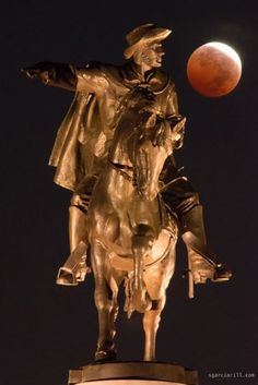 """The October 8th 2014 lunar eclipse from Houston, Texas, featuring a statue of Sam Houston. (Credit and copyright: Sergio Garcia Rill) Mona Evans, """"Lunar Eclipses"""" http://www.bellaonline.com/articles/art28454.asp"""