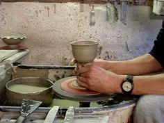 Throwing a clay pottery goblet on a potters wheel.