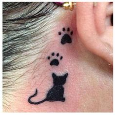 Cat and paw prints tattoo