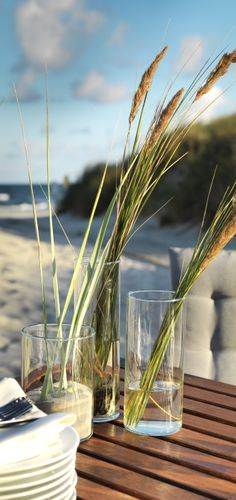 IKEA Wedding Ideas - For an outdoor wedding, embrace the beauty of your surroundings by incorporating the natural landscape into your decor.  One example, for a beach wedding, is to fill CYLINDAR glass vases with sand and sea-grass.