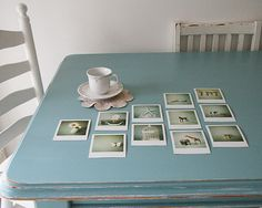 Pictures and photo's displayed on blue table - put glass over the top