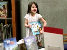 Suri Cruise clutches Froggy Gets Dressed by Jonathan London
