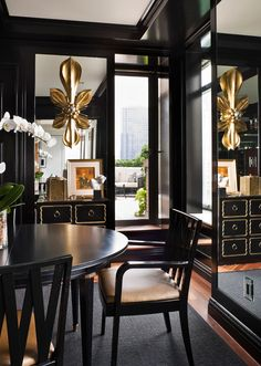 Love the gold in this black room.