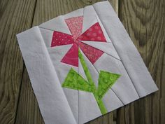My First Paper Pieced Block BY FlossieBlossoms @Tony Gebely Wang: I used the pattern made by Penny at sewtakeahike, the peppermint table runner, shrunk it down to 25% and I added a stem to it and then appliqued on 2 leaves. I knew my skills weren't good enough to piece them in, too. The stem was hard enough! While I've always respected all the paper piecers I know, I admire them even MORE, now...