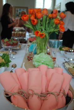 spring decorations... plastic eating utensils. wrapped in colored napkins tied with brown string