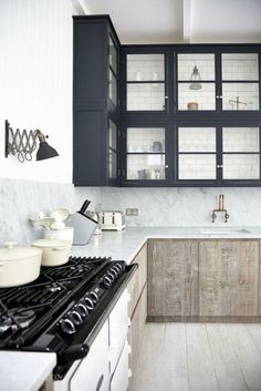 kitchen with navy upper cabinets