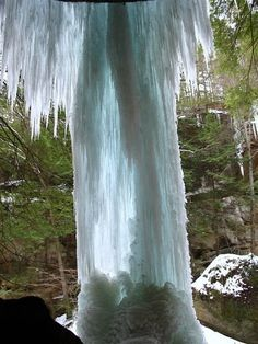 from behind a frozen waterfall