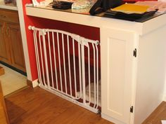 Great idea! Turning a built-in desk into an indoor dog 'crate' with a simple kiddie gate.