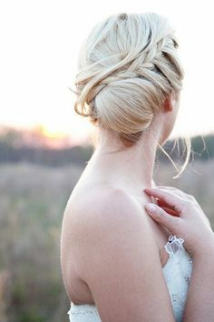 Bridal bun hairstyle with an understated braid for a romantic touch! Braided Wedding Hair Upstyles | Confetti Daydreams ♥  ♥  ♥ LIKE US ON FB: www.facebook.com/confettidaydreams  ♥  ♥  ♥ #Wedding #Braids #Hairstyles #Braided #BridalHair