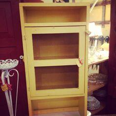 Primitive yellow cabinet