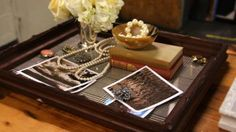 Framed tray with brooches as accent.