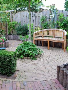 Circular or winding patio shapes are inherently attractive, so you won't have to add much in the way of furniture or decor.