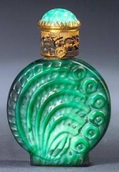 A Czechoslovakian Ingrid mini perfume bottle, circa 1920s, in opaque green crystal, with jeweled metal cap