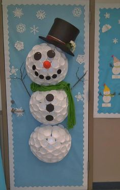 This Winter door decoration is beautiful!!! It was shared by our fan Amy Maxey. She used styrofoam cups hot glued with a low temp glue. It is very light so it is just taped on the door. The hat is a cereal box on its side with black scrapbook paper wrapped on it to form half a hat and then a half circle for the brim with notches (covered with ribbon).