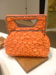 Bubble Wrap handbag! We love this idea! Not to mention, the color is fabulous!