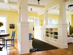 half wall entry with built-ins and chunky columns.