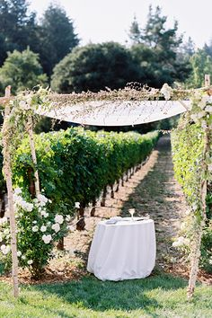 A #rustic chuppah made of birch and flowers | Photography by Leah | Brides.com