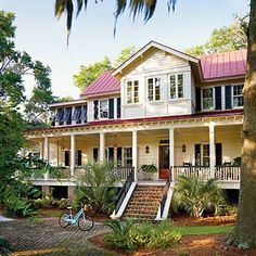 Vintage Lowcountry | This irresistible design recalls the charm and character of the Lowcountry vernacular style. Taking cues from the past, the front porch features wood-clad walls, ceilings, and floors. The pained and hand-crimped standing-seam metal roof further defines a sense of historic charm. | SouthernLiving.com