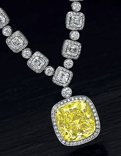 An Important Colored Diamond and Diamond Pendant Necklace, by Tiffany & Co.#necklace #diamond #diamondnecklace #jewellery #tiffany #yellowdiamond