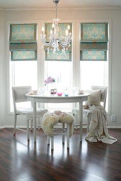 Nice little tea table, sunlight, chandelier and blankets :)