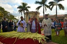 Archbishop Thomas Wenski blesses palm fronds for Palm Sunday outside of St. Mary Cathedral on March 24, 2013 in Miami. Palm Sunday, also known as Sunday of the Passion, marks the beginning of Holy Week for Catholics. Max Reed / FOR THE MIAMI HERALD