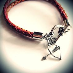 Yeah for the Hunger Games! Leather Katniss bracelet with sterling silver bow and arrow charm. $22 from JewelryByMaeBee on Etsy.