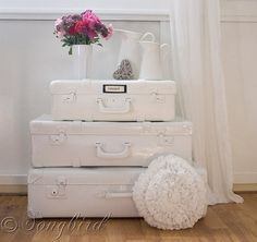 Learn how to create this stack of painted white suitcases via http://www.songbirdblog.com