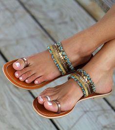 cute sandals, nail polish, and toe rings
