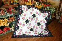 Whirling Daisies by Nancy Mahoney, featured in Quilters Newsletter's Best Fat Quarter Quilts 2012