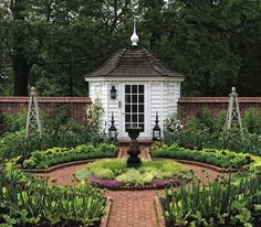 Classical, Walled Potager (Kitchen) Garden with potting shed, brick paths, center-placed urn, and trellis-form accents for growing climbing vegetables or flowering vines.