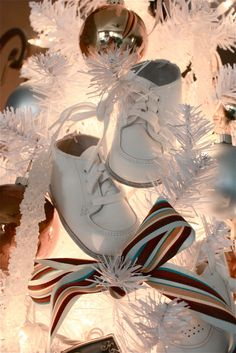 Never thought of putting the baby shoes on the Christmas tree...what a sweet way to keep them!